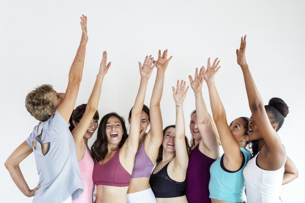 Group of diverse people in yoga class