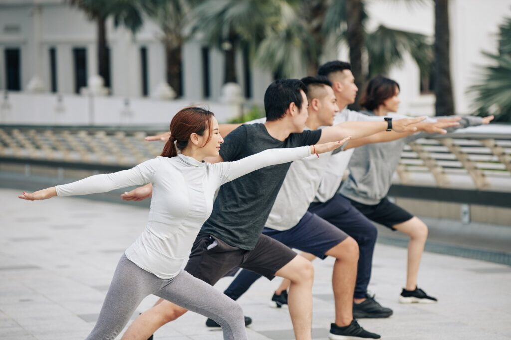 Young people practicing yoga